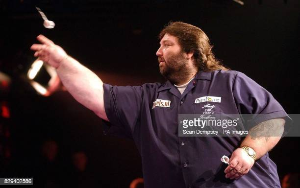 Andy Fordham launches his dart during the headtohead showdown against Phil 'The Power' Taylor at Circus Tavern Purfleet Fordham has the disadvantage...