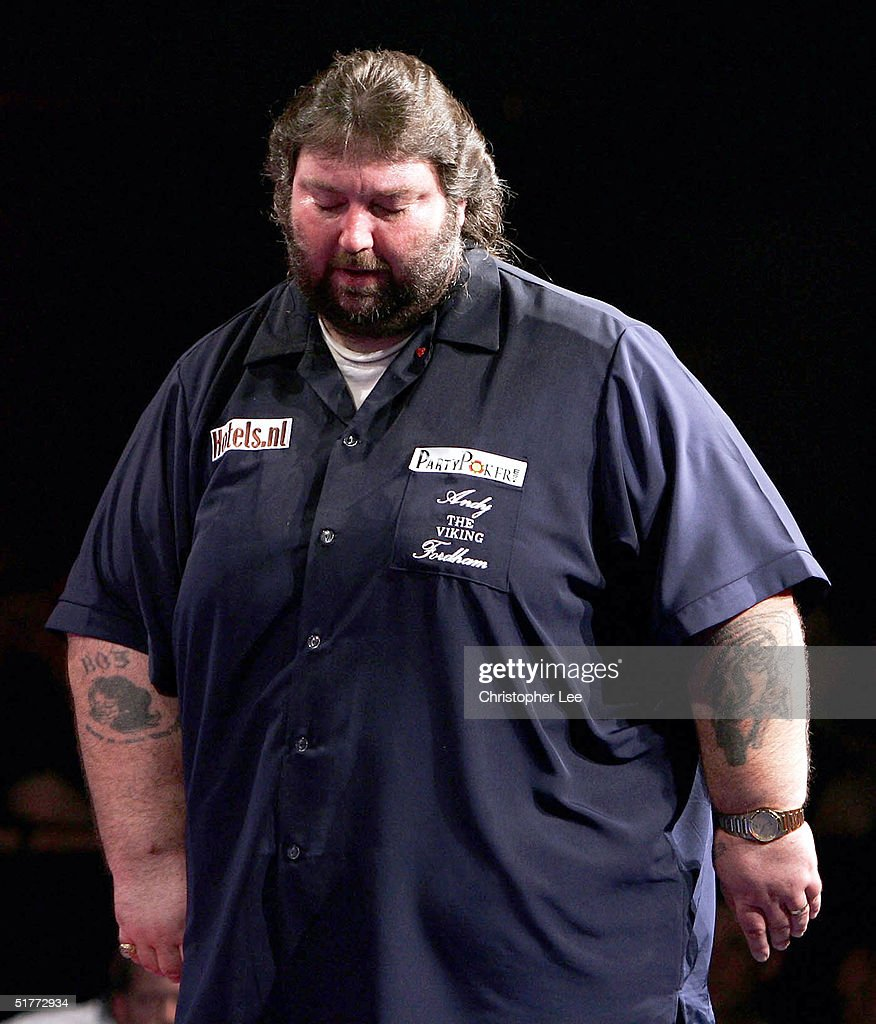 Andy Fordham looks dejected during his showdown match against Phil Taylor at The Circus Tavern on November 21, 2004 in Purfleet, England.
