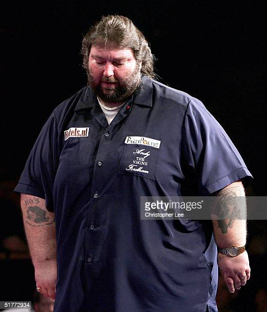 Andy Fordham looks dejected during his showdown match against Phil Taylor at The Circus Tavern on November 21 2004 in Purfleet England