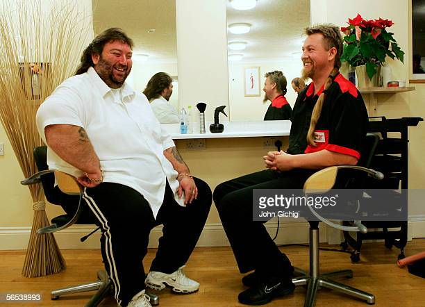 Andy Fordham of England has a laugh with Simon Whitlock of Australia prior to their game on Sunday during the BDO World Darts Championships on...