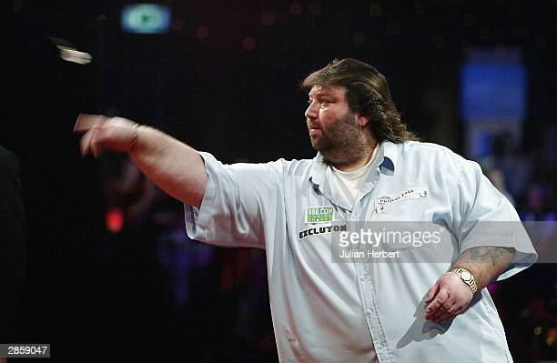 Andy Fordham of England in action against Mervyn King of England during the final of The BDO Lakeside World Darts Championships at the Lakeside on...