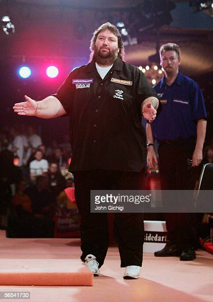 Andy Fordham of England reacts as he loses to Simon Whitlock of Australia during the BDO World Darts Championship at the Lakeside on January 8...