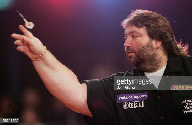 Andy Fordham of England throws againts Simon Whitlock of Australia during the BDO World Darts Championships at the Lakeside on January 8 Frimley...