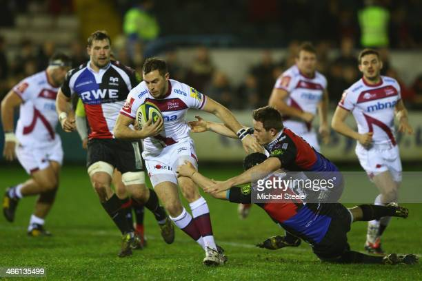 Andy Forsyth of Sale Sharks bursts past the challenge of Sam Davies and Lloyd Evans of Ospreys during the LV Cup match between Ospreys and Sale...