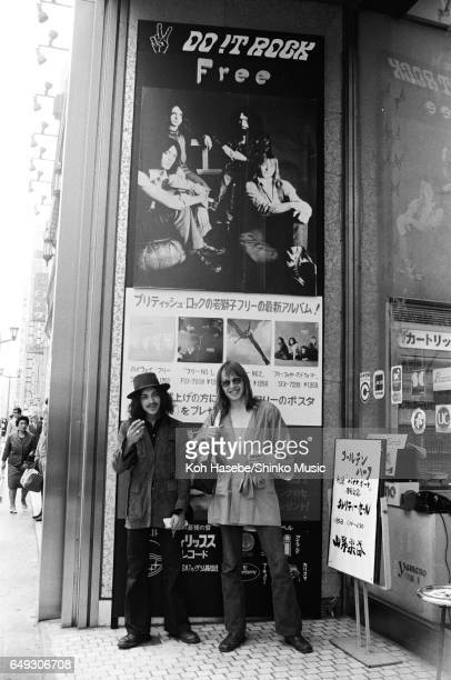 Andy Fraser and Simon Kirke standing in front of FREE's advertisement April 1970