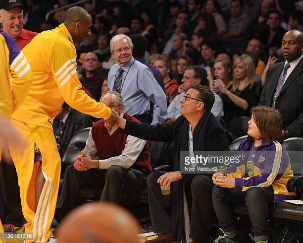 Andy Garcia and Andres Garcia-Lorido greet Kobe Bryant at the Los Angeles Lakers vs Utah Jazz game on December 25, 2011 in Los Angeles, California.