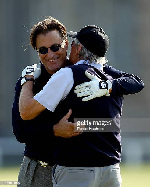 Andy Garcia and Michael Douglas embrace on the second tee during the final practice round of The Alfred Dunhill Links Championship at The Old Course...