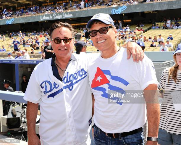 Andy Garcia and Steven Bauer attend a baseball game between the San Diego Padres and the Los Angeles Dodgers at Dodger Stadium on September 1 2013 in...