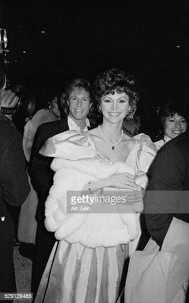 Andy Gibb and Victoria Principal entering event circa 1970 New York
