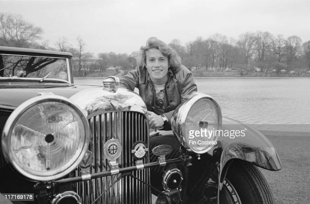Andy Gibb British pop singer posing by a vintage Lagonda car in London England Great Britain in March 1978 Gibb was the youngest brother of Barry...