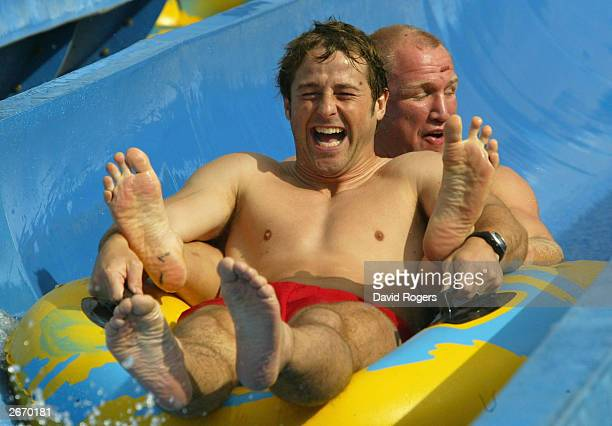 Andy Gomarsall and Neil Back of England enjoy the waterslide at the Wet 'n' Wild theme park October 28 2003 the Gold Coast Australia