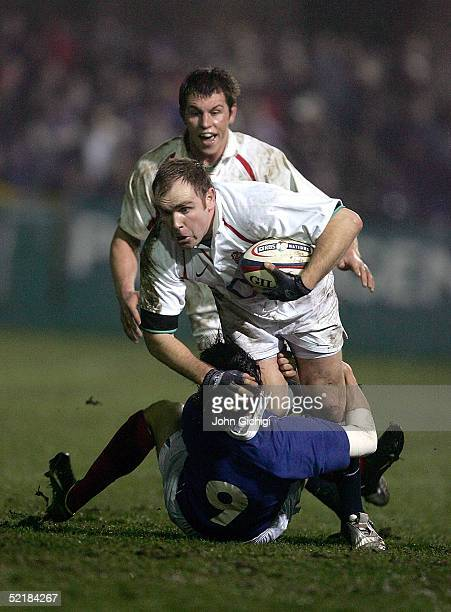 Andy Goode of England is tackled by Nicolas Durand of France during the international match between England A and France A on February 11 2005 at the...