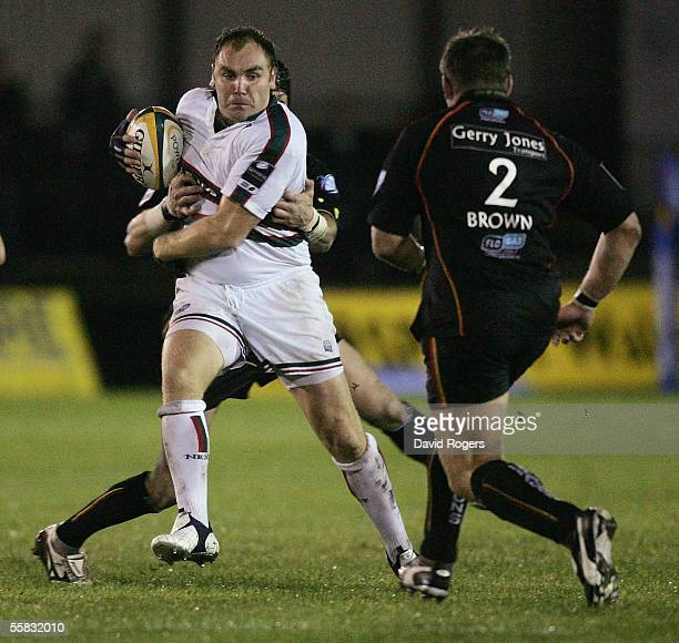 Andy Goode of Leicester takes on Andrew Brownduring the Powergen Cup match between NewportGwent Dragons and Leicester Tigers at Rodney Parade on...
