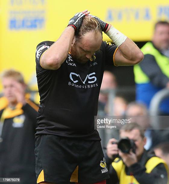 Andy Goode of Wasps holds his head in dejection after missing the conversion of Tom Palmer's try which would have won the match during the Aviva...