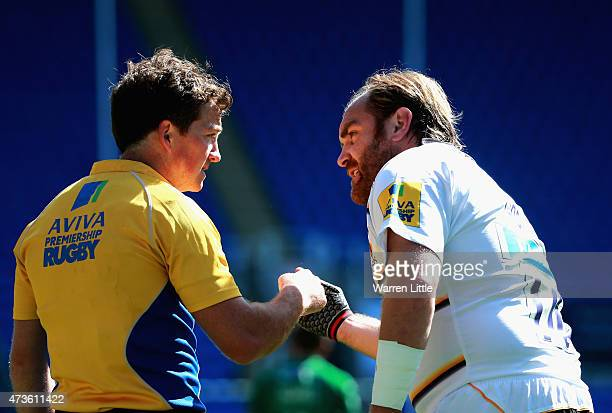 Andy Goode of Wasps speaks with referee JP Doyle during the Aviva Premiership match between London Irish and London Wasps at Madejski Stadium on May...