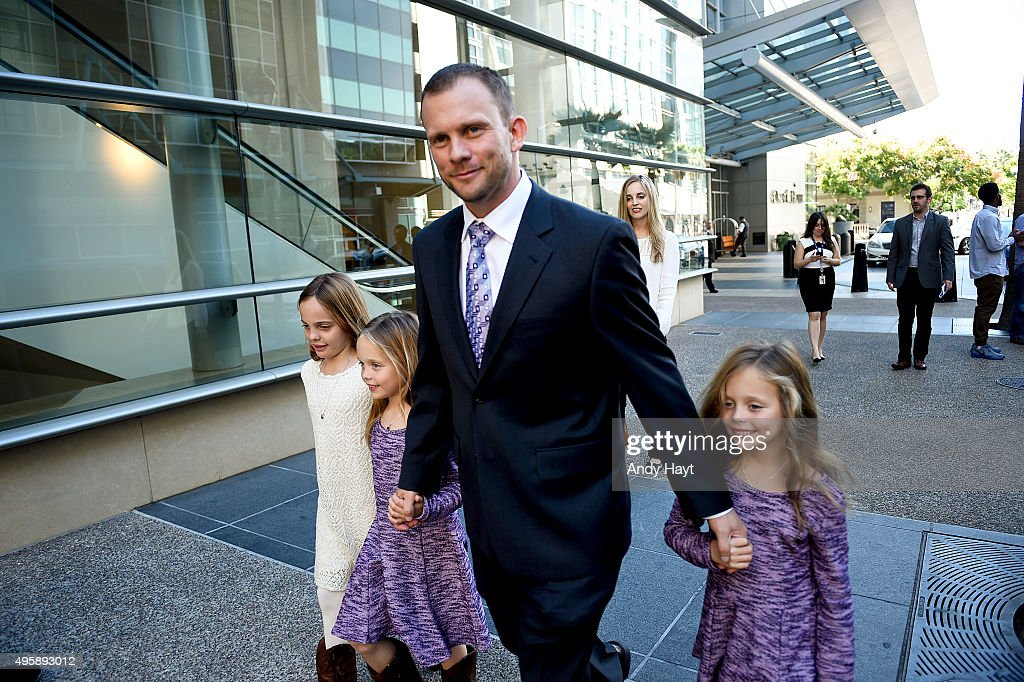 Andy Green and his family walk to a press conference where he is introduced as the new Manager of the San Diego Padres at Petco Park on October 15, 2015 in San Diego, California.