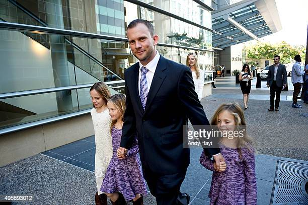 Andy Green and his family walk to a press conference where he is introduced as the new Manager of the San Diego Padres at Petco Park on October 15...