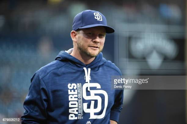 Andy Green manager of the San Diego Padres walks off the field before a baseball game against the Colorado Rockies at PETCO Park on May 2 2017 in San...