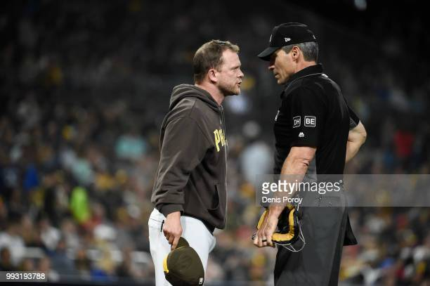 Andy Green of the San Diego Padres argues with home plate umpire Angel Hernandez after being thrown out of the game during the fourth inning of a...