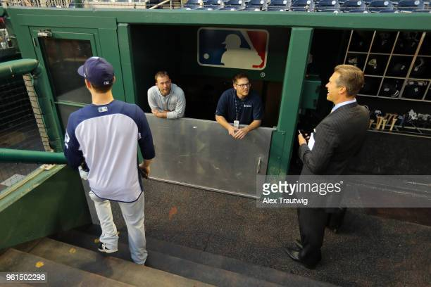 Andy Green of the San Diego Padres looks on after the dugout was prepared for a severe storm ahead of a game against the Washington Nationals at...