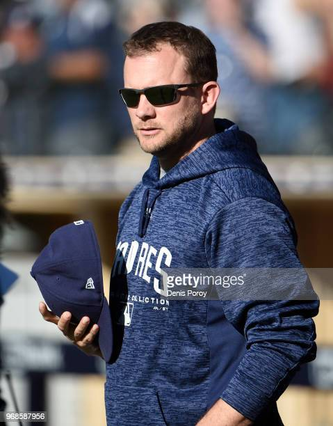 Andy Green of the San Diego Padres looks on before a baseball game against the Cincinnati Reds at PETCO Park on June 2 2018 in San Diego California
