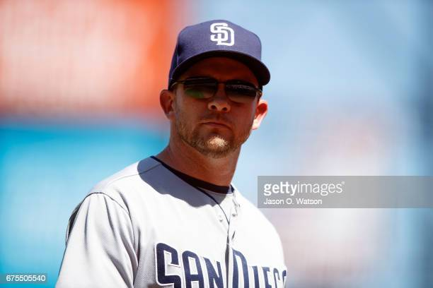 Andy Green of the San Diego Padres returns to the dugout after making a pitching change against the San Francisco Giants during the sixth inning at...