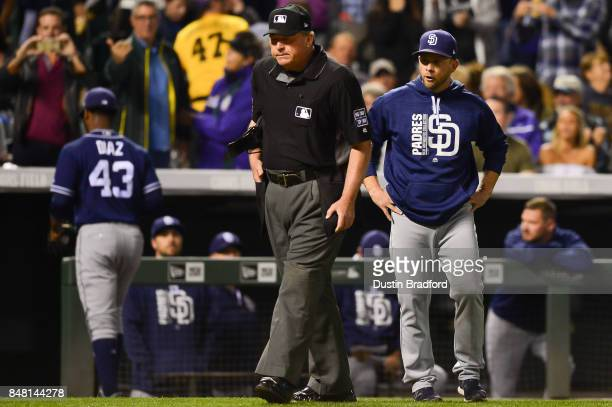 Andy Green of the San Diego Padres shares his thoughts with umpire Gerry Davis after Miguel Diaz was ejected after hitting a batter with a pitch in...