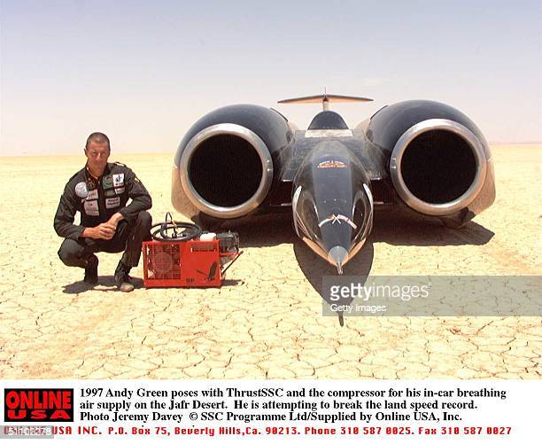 Andy Green Poses With Thrustssc And The Compressor For His InCar Breathing Air Supply On The Jafr Desert He Is Attempting To Break The Land Speed...