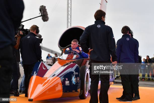 Andy Green Royal Air Force Wing Commander is interviewed as he sits in the cockpit of the Bloodhound supersonic car on the tarmac at the airport in...