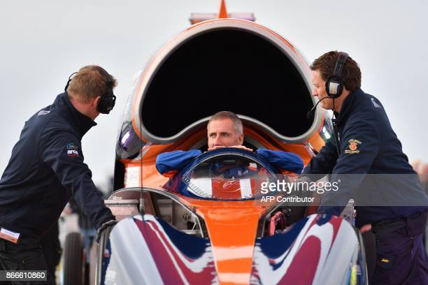 Andy Green Royal Air Force Wing Commander sits in the cockpit of the Bloodhound supersonic car as he talks to technicians before starting a test run...