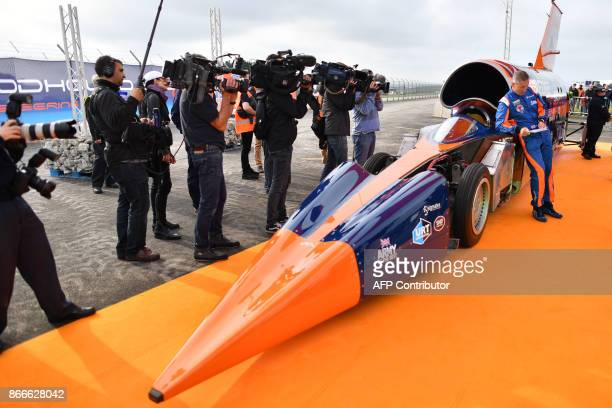 Andy Green Royal Air Force Wing Commander stands alongside the Bloodhound supersonic car as he prepares for a test run at the airport in Newquay on...