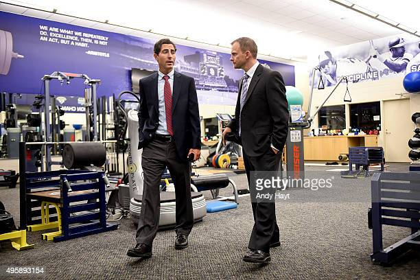 Andy Green visits with AJ Preller in in the clubhouse gym prior to his introduction to the media as the new Manager of the San Diego Padres at Petco...