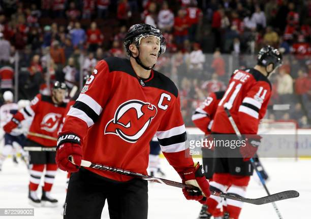 Andy Greene and Brian Boyle of the New Jersey Devils skate off the ice after losing 32 in overtime to the Edmonton Oilers on November 9 2017 at...