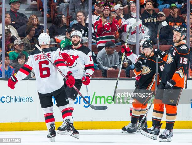 Andy Greene and Patrick Maroon of the New Jersey Devils celebrate Maroon's thirdperiod goal as Rickard Rakell and Ryan Getzlaf of the Anaheim Ducks...