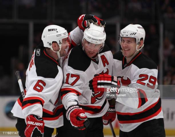 Andy Greene Ilya Kovalchuk and Anssi Salmela of the New Jersey Devils celebrate Kovalchuk's goal at 918 of the first period against the New York...
