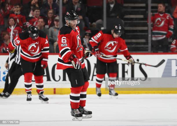 Andy Greene of the New Jersey Devils and the rest of his teamamtes react to the loss to the Carolina Hurricanes on March 25 2017 at Prudential Center...