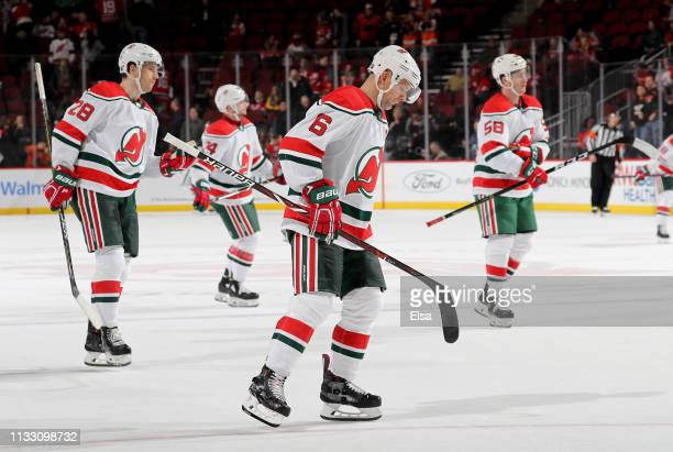 Andy Greene of the New Jersey Devils and the rest of his teammates skate off the ice after losing to the Philadelphia Flyers on March 01 2019 at...