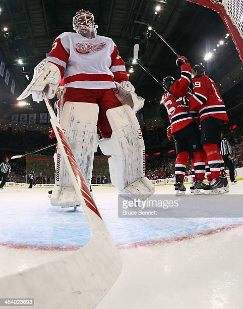 Andy Greene of the New Jersey Devils celebrates a first period goal against Jonas Gustavsson of the Detroit Red Wings at the Prudential Center on...