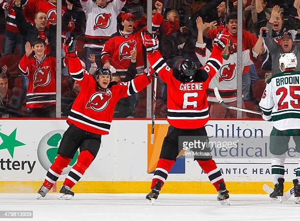 Andy Greene of the New Jersey Devils celebrates his overtime goal against the Minnesota Wild with teammate Patrik Elias at the Prudential Center on...
