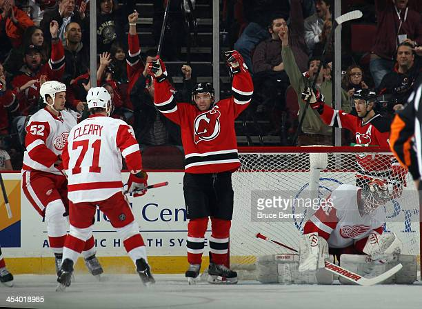 Andy Greene of the New Jersey Devils celebrates his powerplay goal at 1343 of the first period against Jonas Gustavsson of the Detroit Red Wings at...