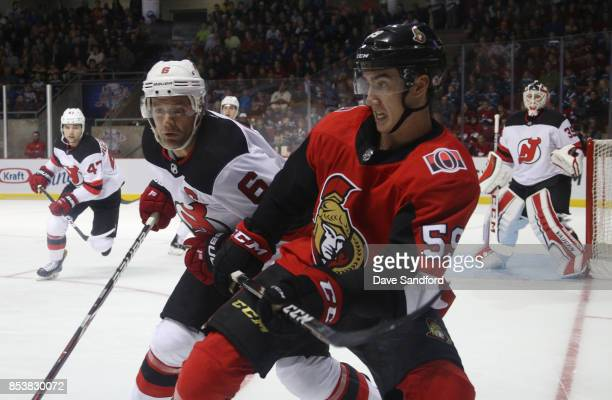 Andy Greene of the New Jersey Devils checks Alex Formenton of the Ottawa Senators during Kraft Hockeyville Canada on September 25 2017 at Credit...