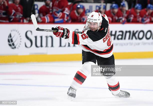 Andy Greene of the New Jersey Devils fires a slap shot against the Montreal Canadiens in the NHL game at the Bell Centre on January 6 2015 in...