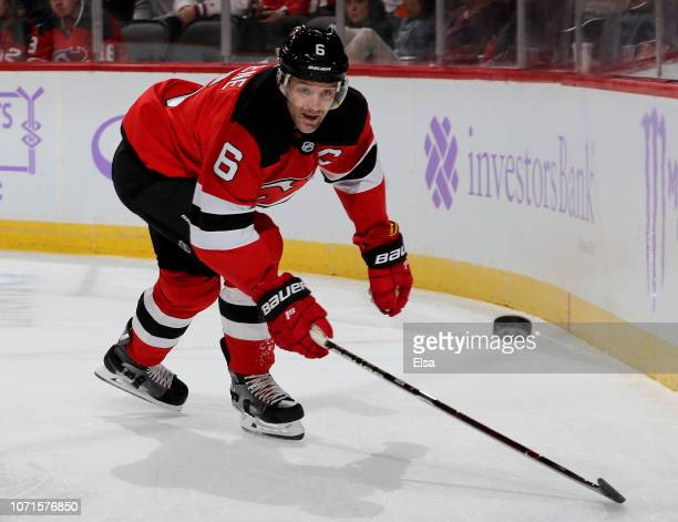 Andy Greene of the New Jersey Devils goes after the puck in the second period against the New York Islanders at Prudential Center on November 23 2018...