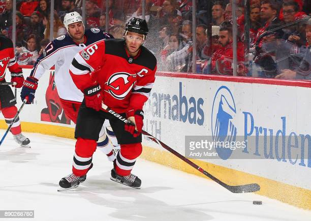 Andy Greene of the New Jersey Devils plays the puck against the Columbus Blue Jackets during the game at Prudential Center on December 8 2017 in...