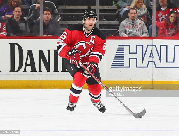 Andy Greene of the New Jersey Devils plays the puck against the New York Islanders during the game at Prudential Center on April 8 2017 in Newark New...