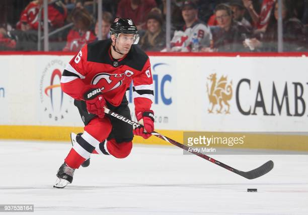 Andy Greene of the New Jersey Devils plays the puck during the game against the Tampa Bay Lightning at Prudential Center on March 24 2018 in Newark...