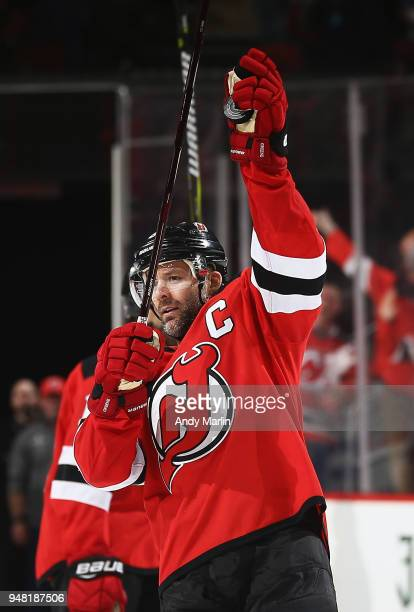 Andy Greene of the New Jersey Devils salutes the fans after defeating the Tampa Bay Lightning in Game Three of the Eastern Conference First Round...