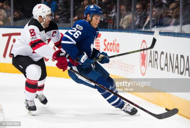 Andy Greene of the New Jersey Devils skates against Nikita Soshnikov of the Toronto Maple Leafs during the first period at the Air Canada Centre on...