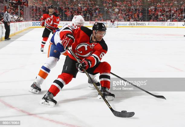 Andy Greene of the New Jersey Devils skates against the New York Islanders at the Prudential Center on April 8 2017 in Newark New Jersey The...