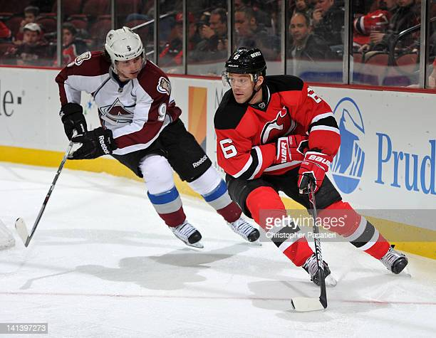 Andy Greene of the New Jersey Devils skates with the puck against Matt Duchene of the Colorado Avalanche during the game on March 15 2012 at the...